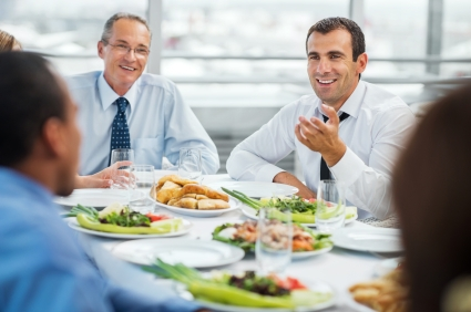 Lunch break. Group of successful businesspeople sitting and eating. [url=http://www.istockphoto.com/search/lightbox/9786622][img]http://dl.dropbox.com/u/40117171/business.jpg[/img][/url]